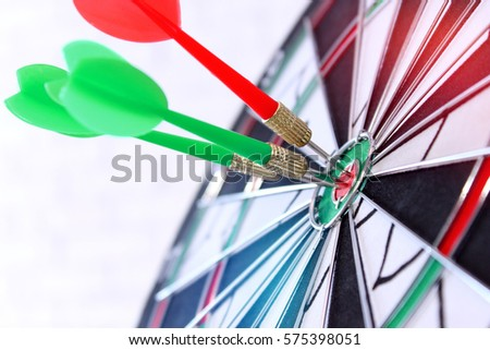 Darts in the center of the target close-up