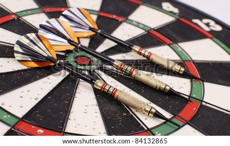 Darts on Dart Board in Shallow DoF - stock photo
