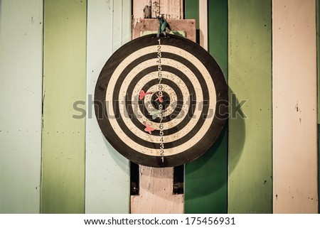 Darts on Target/wood background - stock photo
