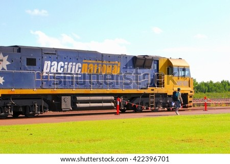 DARWIN, AUSTRALIA - March 20. Backpacker is in motion and will depart with the Ghan train from Darwin railway station to Alice Springs / Adelaide on March 20, 2013 in Darwin.  - stock photo