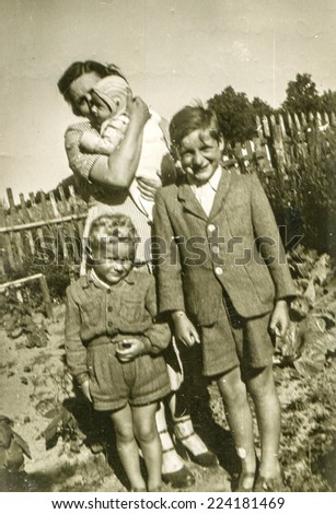 DARZLUBIE, POLAND, CIRCA AUGUST 1953: Vintage photo of mother with sons
