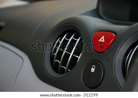 Dashboard detail of air vents section, hazard button and central locking button