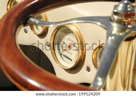 dashboard dials on a retro custom car - stock photo