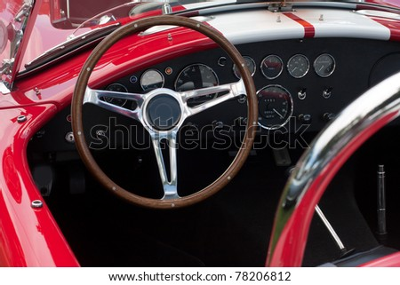 dashboard of a convertible  sports car with roof down - stock photo