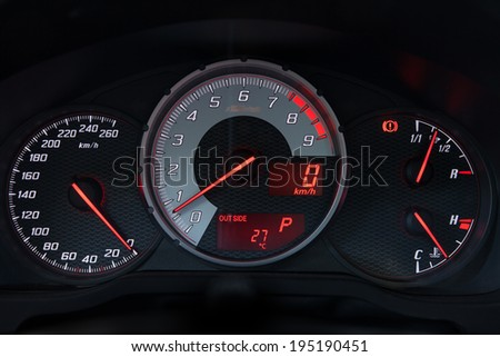 Dashboard of a modern sports car, speedometer, RPM pointer, temperature, fuel tank