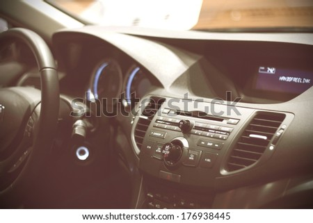 Dashboard of a sports car. Beautiful interior. - stock photo