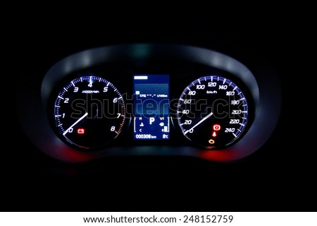 Dashboard of modern car on a black background