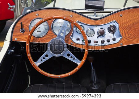 Dashboard of the vintage car - stock photo