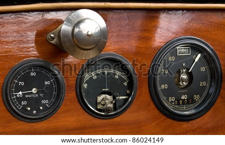 Dashboard with gauge meters from an old thirties vintage car. - stock photo