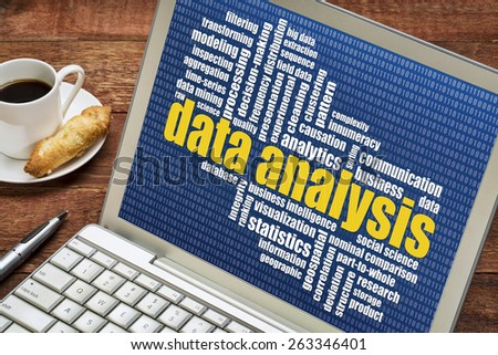 data analysis word cloud on a laptop with a cup of coffee - stock photo