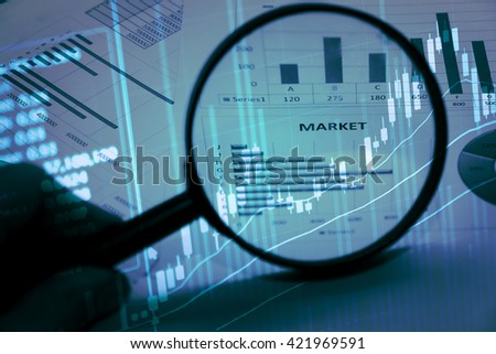 Data analyzing in forex market with magnifying glass, pen and calculator : the charts and summary info on paper. Charts of financial instruments for technical analysis. - stock photo