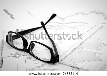 data analyzing in stock market: on the charts and quotes prints, the eyeglasses