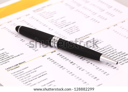 Data analyzing in stock market on the quotes prints, and a pen