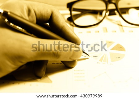 Data analyzing in trading market with pen. Working set for analyzing financial statistics and analyzing a market data. Data analyzing from charts and graph to find out the result. - Mono tone. - stock photo