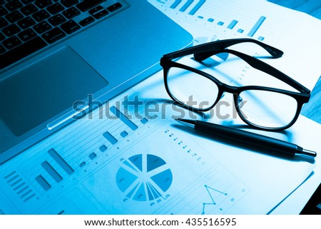 Data analyzing in trading market with pen. Working set for analyzing financial statistics and analyzing a market data. Data analyzing from charts and graph to find out the result. - Vintage tone. - stock photo