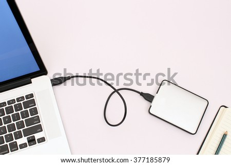 Data back up to external hard drive.  - stock photo