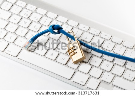 Data cable, combination lock and Computer Keyboard - stock photo