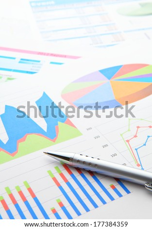 Data chart and pen - stock photo