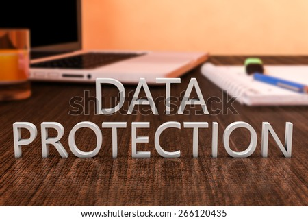 Data Protection - letters on wooden desk with laptop computer and a notebook. 3d render illustration. - stock photo