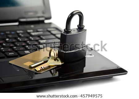 Data security concept with padlock key on laptop computer keyboard and credit card - stock photo