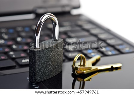 Data security concept with padlock on laptop computer keyboard - stock photo