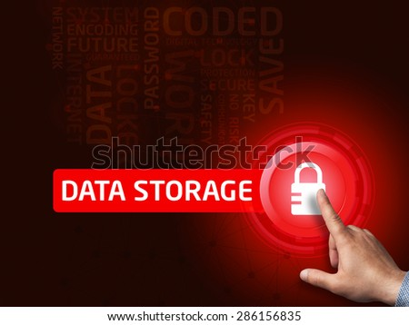 Data storage. Businessman presses a button on the virtual screen. Business, technology, internet and networking concept. - stock photo