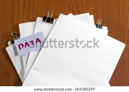 Data; White Blank Documents with Small Message Card. - stock photo