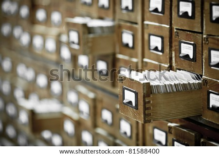 database concept. vintage cabinet. library card or file catalog. - stock photo