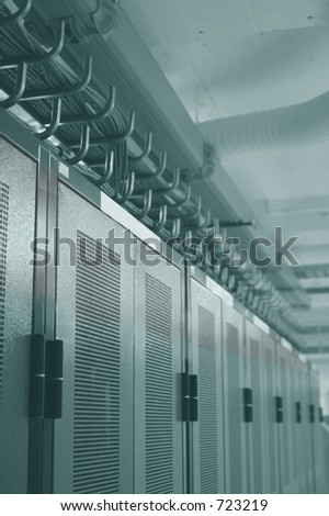 Datacenter racks and overhead cable management - stock photo