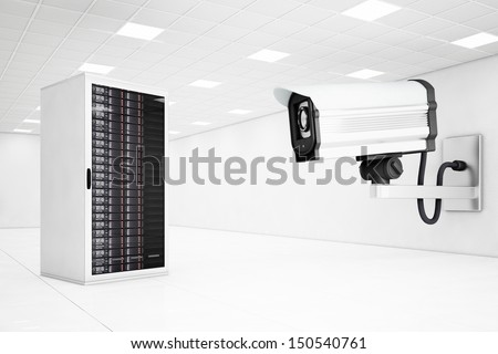 datacenter with a big cctv camera looking at computers - stock photo