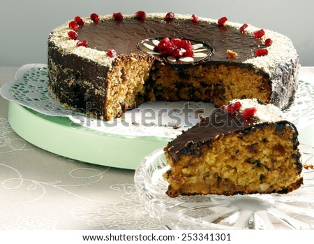 date cake with chocolate icing - stock photo