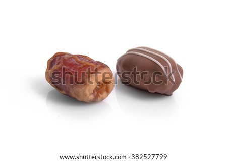 Date fruit and date-chocolate placed side by side on white background - stock photo