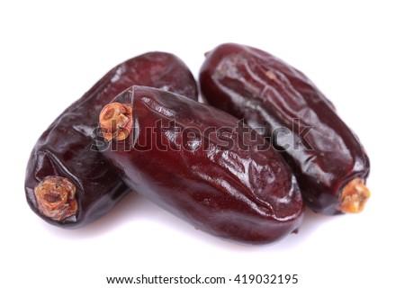 Date fruits close up isolated on white under studio lighting - stock photo