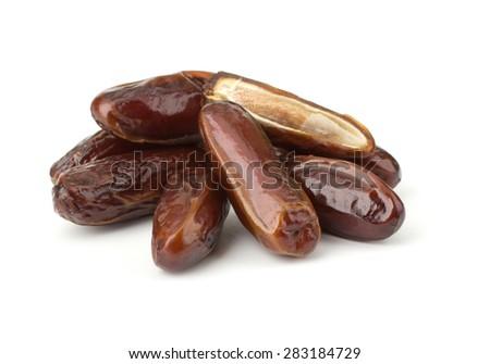 Date fruits isolated on white background - stock photo