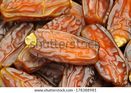 Date fruits stacked under studio lighting - stock photo