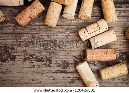 Dated wine bottle corks on the wooden background. Close up - stock photo