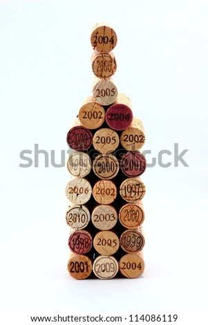 Dated wine corks in the shape of a wine bottle - stock photo