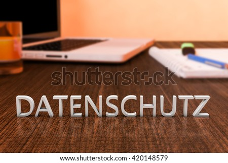 Datenschutz - german word for protection of data privancy - letters on wooden desk with laptop computer and a notebook. 3d render illustration. - stock photo
