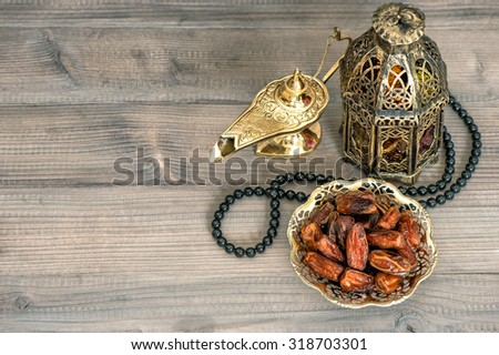 Dates, arabian lantern and rosary. Eid Mubarak. Islamic holidays - stock photo