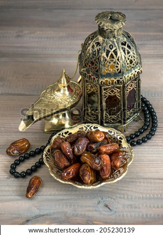 Dates, arabic lamps and rosary. Islamic holidays concept - stock photo