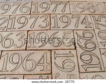 dates in the concrete - stock photo