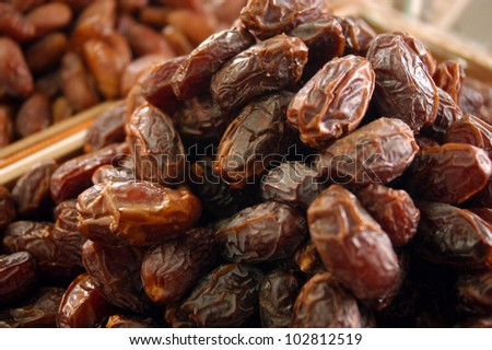 Dates on display in the market. - stock photo