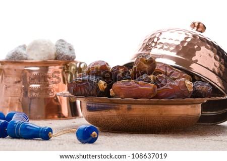 Dates, prayer beads and Turkish delight traditional Ramadan symbols - stock photo
