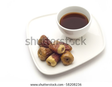 Dates with a cup of black coffee - stock photo
