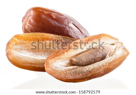 dates with a half isolated on white - stock photo
