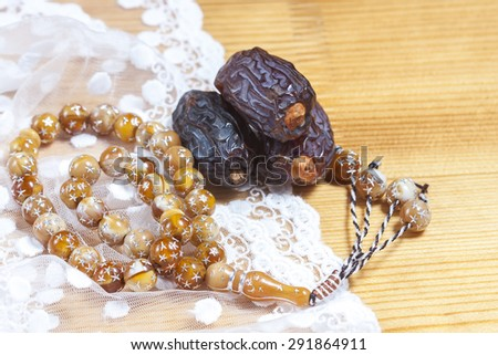 Dates  with islamic rosary. Selective focus - stock photo