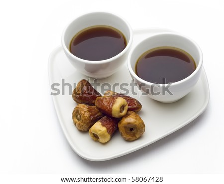 Dates with two cups of black coffee - stock photo
