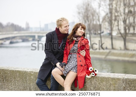 Dating couple at the Parisian embankment at misty day - stock photo