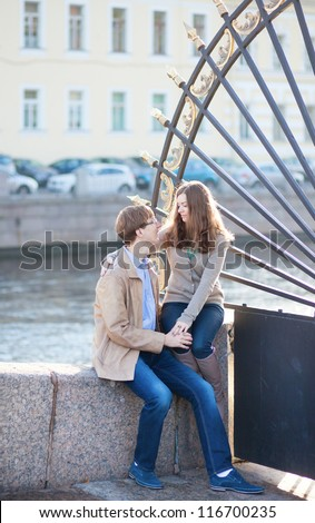 Dating couple close to the famous grill of the Summer garden in Saint-Petersburg, Russia - stock photo