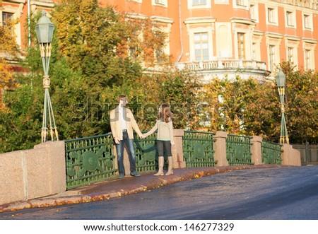 Dating couple enjoying autumn day - stock photo